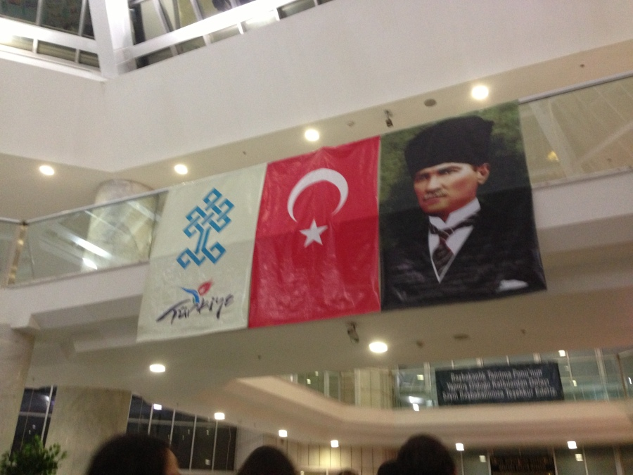 banners hanging in the lobby of the Mevlana Cultural Centre in Konya