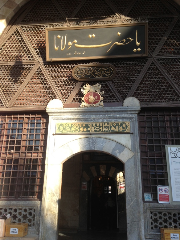 "the entrance to Rumi's tomb. The large inscription above the door is an invocation: ""ya Hazreti Mevlana"""