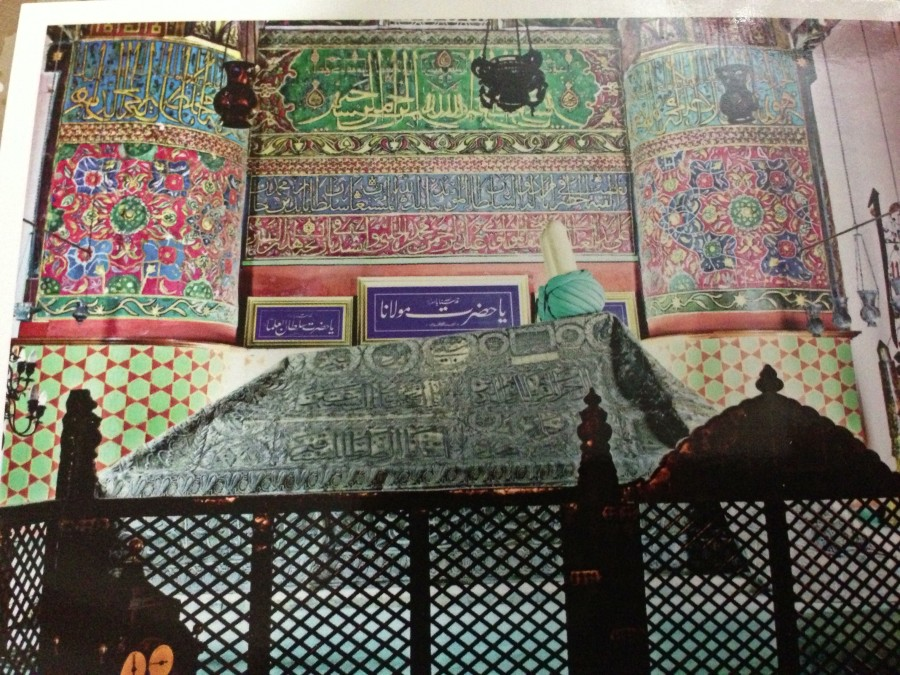 My photograph of a postcard (purchased at the gift shop of the museum) of Rumi's tomb. Out of respect for the museum's regulations, and more importantly, for those praying around me, I obliged the no photography rule.